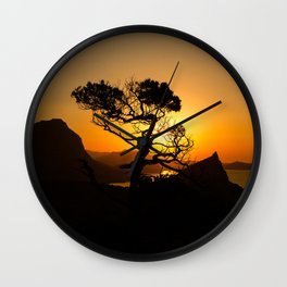 Sunrise in mountains with tree and sea Wall Clock
