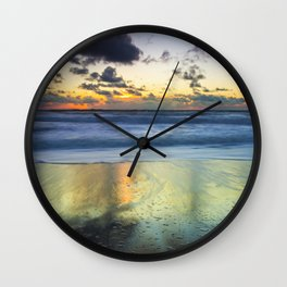 Sea storm approaching the beach making reflections in the sand Wall Clock