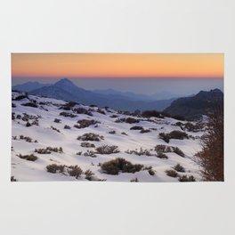 Orange sunset at the mountains. Sierra Nevada Rug