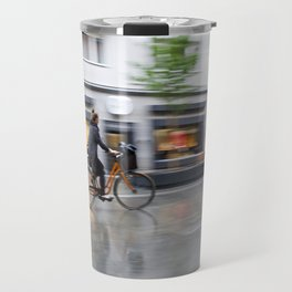young woman on her bicycle traveling in the rain Travel Mug