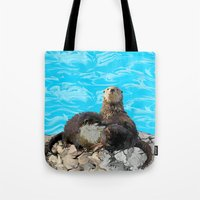 otters Tote Bags featuring Where the River Meets the Sea Otters by Distortion Art