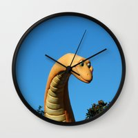 dinosaur Wall Clocks featuring Dinosaur by Ink and Paint Studio