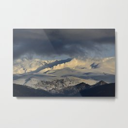 Snowy mountains through the clouds. Metal Print