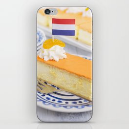 Orange tompouce, traditional Dutch pastry, on a rustic table iPhone Skin