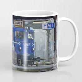 Train at railway station Coffee Mug