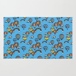 Colorful Hot Air Balloon Surrounded By Clouds and Rainbows Pattern Blue Background Rug