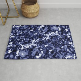 A pastel cluster of blue bodies on a light background. Rug