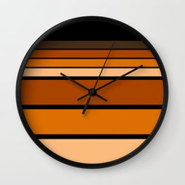 Black and yellow , brown and orange striped pattern . Wall Clock