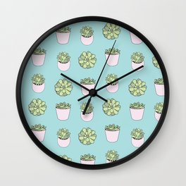 Green suculents in pink flowerpots on mint background Wall Clock