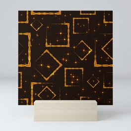 Golden rhombuses and squares in the intersection with the night stars on a brown background. Mini Art Print