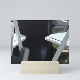 Four White Wooden Chairs... Mini Art Print