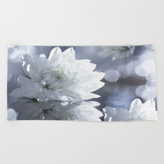 White flower with bokeh on a grey background included wonderful light Beach Towel
