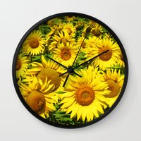 sunflowers Wall Clocks featuring Sunflowers. by Assiyam