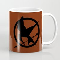 mockingjay Mugs featuring Mockingjay by Jessica Wray