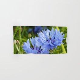 two blue flowers of cornflower in green grass Hand & Bath Towel