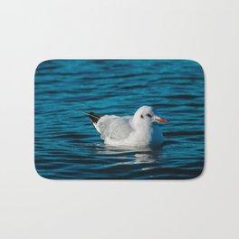 Swimming sea gull Bath Mat