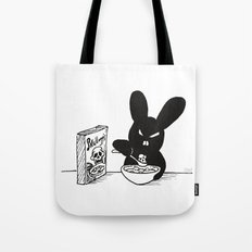The Black Bunny of Doom enjoying his breakfast Tote Bag