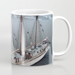 Sailing Ship in front of a Mountain Valley in Norway Coffee Mug