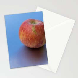 fresh tasty red apple and reflection of the sky Stationery Cards