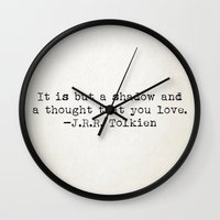 "tolkien Wall Clocks featuring ""It is but a shadow and a thought that you love."" -J.R.R. Tolkien by Typed Book Quotes"