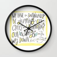 vonnegut Wall Clocks featuring jumping off cliffs - kurt vonnegut quote by Shaina Anderson