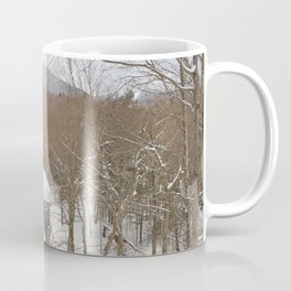 Red covered bridge in snowy landscape Coffee Mug
