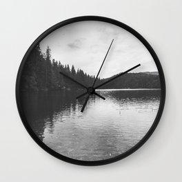 Reflections on black & white lake Wall Clock
