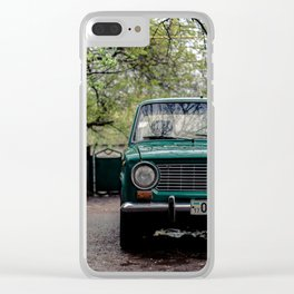 Retro car in the cloudy weather, in countryside yard. Clear iPhone Case