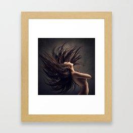 Woman waving long dark hair Framed Art Print