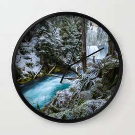 Blue River Waterfall Flows Through Snowy Forest Wall Clock