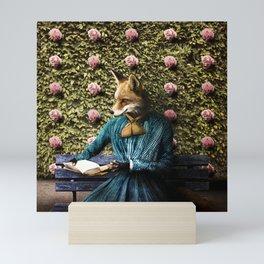Fiona Fox reading in the garden Mini Art Print