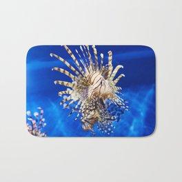 Poisonous lionfish in blue water sea Bath Mat