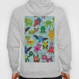 Cute cartoon Monsters seamless pattern on blue background Hoody
