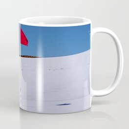 Red flag on Stromness golf course on a snowy April day. Coffee Mug