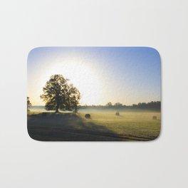 Sunrise in a Rural Hayfield Bath Mat