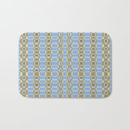 PAYNE gold link chains on pale blue background Bath Mat