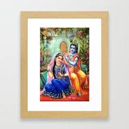 Lord Krishna Putting flowers in Radha's hair Framed Art Print