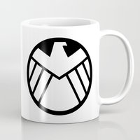 agents of shield Mugs featuring SHIELD by Merioris
