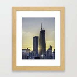 Sunlight peeking through Chicago skyscrapers Framed Art Print