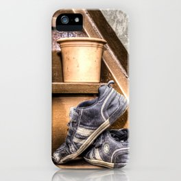 Old children's shoes on a stairway iPhone Case