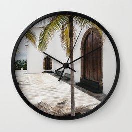 Palm tree growing in the street. La Palma, Canary Island. Wall Clock
