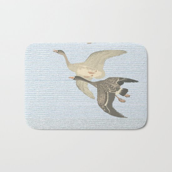 Nothing to match the flight of wild birds flying Bath Mat