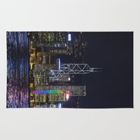 hong kong Area & Throw Rugs featuring Hong Kong Night Skyline by Deborah Janke