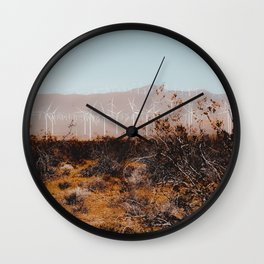 Desert and wind turbine with mountain background at Kern County California USA Wall Clock