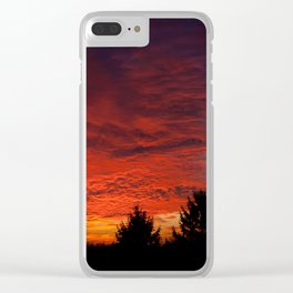 Red sunset and trees silhouette in Warsaw Clear iPhone Case
