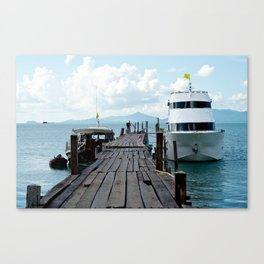The pier and boat Canvas Print