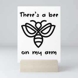 There's a bee on my arm Mini Art Print