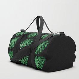 Split leaf Philodendron pattern on dark background Duffle Bag