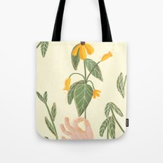 Flower in a hand Tote Bag