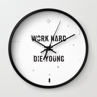die hard Wall Clocks featuring Work Hard, Die Young / Light by Attitude Creative